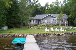 Haliburton Cottage exterior with dock and shoreline.