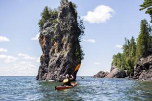 Kayaking along the shore at Aqua Log Cabin Resort.