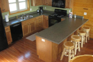 Kitchen of Moonlight Bend has full size appliances and stocked with kitchen essentials