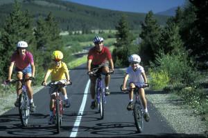 Family biking at Grand Timber Lodge.
