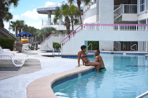 Couple by pool at Crown Reef Resort.