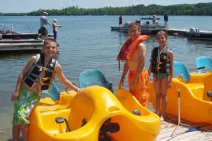 Kids using paddle boats at Thunder Lake Lodge.