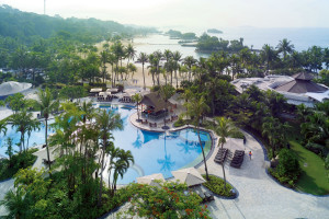 Outdoor pool and beach at Shangri-La's Rasa Sentosa Resort-Singapore.