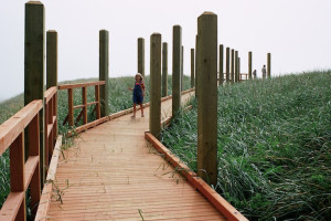 Jogging on boardwalk at Shorepine Vacation Rentals.