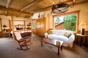 Cabin bedroom at Sorrel River Ranch Resort & Spa.