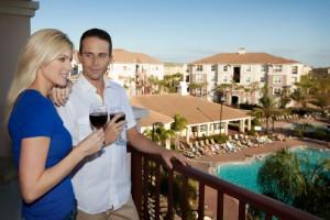 Couple on balcony at Vista Cay Resort.