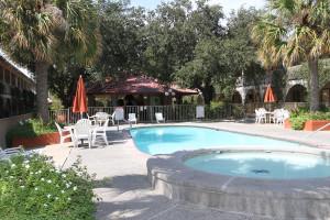 Outdoor pool at Family Gardens Inn.
