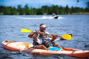 Family kayaking at Holiday Inn Club Vacations at Orange Lake Resort.
