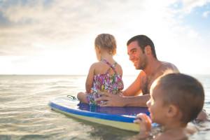 Family swimming at McCreary's Beach Resort.