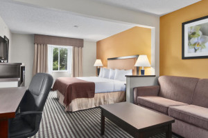 Guest room at Baymont Inn & Suites Dallas Love Field North.