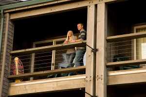 Couple on balcony at Inn at Cape Kiwanda.