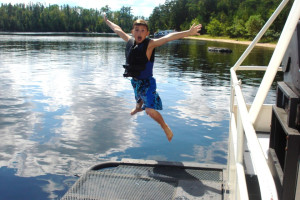 Jumping into the lake at Voyagaire Lodge and Houseboats.