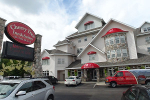 Exterior view of The Cherry Tree Inn & Suites.