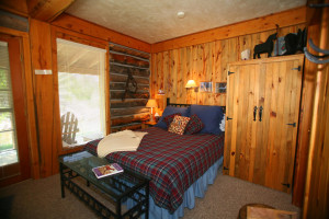 Cabin bedroom at Vee-Bar Guest Ranch.