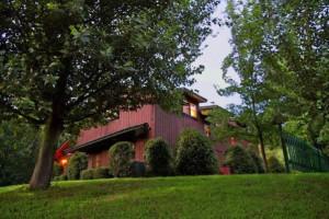 Exterior view of Cedar House Inn & Yurts.
