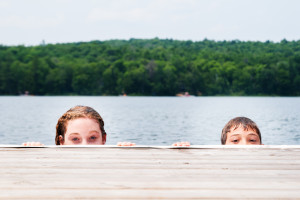 Kids swimming in lake at Sojourn Lakeside Resort.