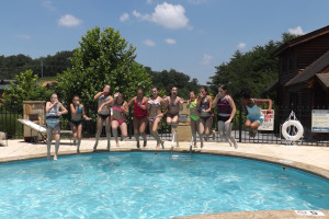 Jumping in the pool at Golfview Vacation Rentals.