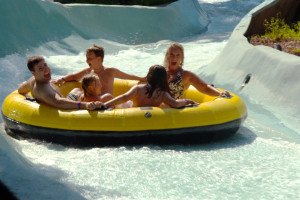 Family on Wild River at Zoom Flume.