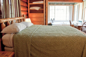 Cabin bedroom at High Country Guest Ranch.