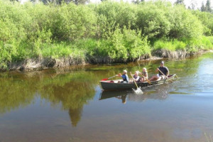Family canoeing at Vacasa Rentals Sunriver.