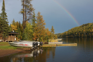 Rainbow over lake at Golden Eagle Lodge.