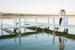Wedding couple on dock at The Ridge Hotel.