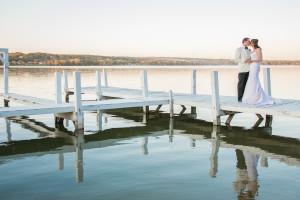 Wedding couple on dock at The Ridge Hotel.