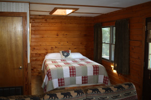 Cabin bedroom at  Arkansas White River Cabins.