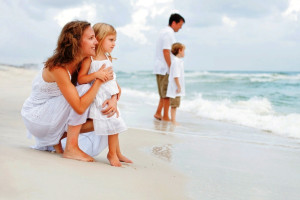 Family on beach at Newman-Dailey Resort Properties, Inc.