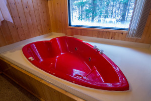 Heart shaped hot tub at Tallpine Lodges.