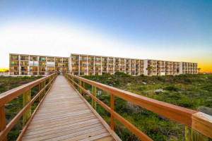 Boardwalk to beach at Beacher's Lodge Oceanfront Suites.