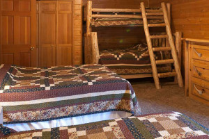 Log home bedroom at 320 Guest Ranch.