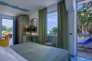 Guest room at Carlo Magno Hotel.