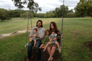 Family on swing at Haven River Inn.