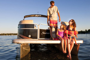 Family boating at Westgate River Ranch Resort & Rodeo.