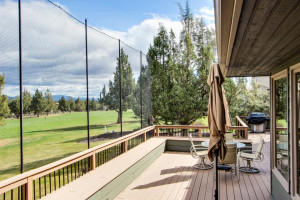 Vacation rental deck looking out on golf course at Vacasa Rentals Eagle Crest.