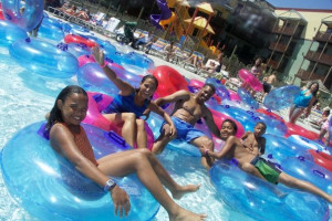 Family swimming at waterpark at Kalahari Waterpark Resort Convention Center.