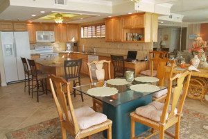 Vacation rental dining table and kitchen at Resort Rentals.