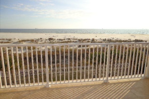 Rental balcony at Beachfront Rentals and Sales.