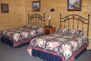 Cabin bedroom at 7C's Lodging.