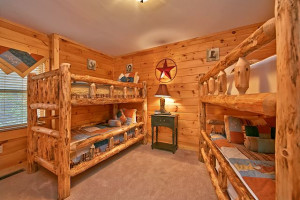 Rental bedroom at Smoky Mountains Vacation Cabins, LLC.