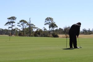 Golfing at Luxury Coastal Vacations.
