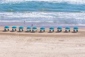 Beach with umbrellas at Padre Getaways.