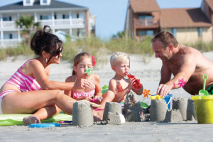 Family on Myrtle Beach at Mar Vista Resort Grande.