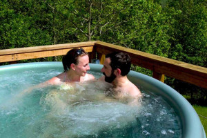Couple in hot tub at Stone Wind Retreat.