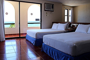 Guest room at Suites Bahia.