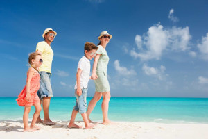 Family on beach at The Sofia Hotel.