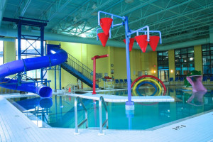 Indoor pool with slide at Lancaster DoubleTree Resort by Hilton.