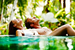 Couple relaxing in pool at Barefeet Rentals.