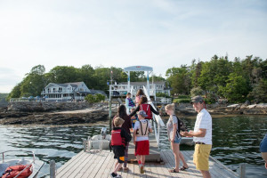 Family on dock at Linekin Bay Resort.